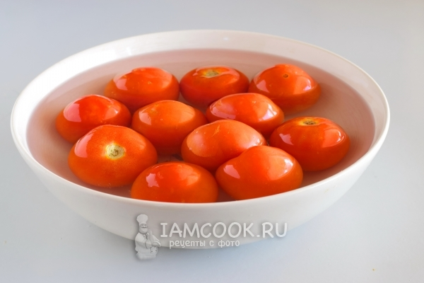 Put the tomatoes in boiling water