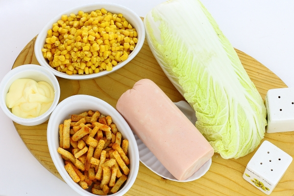Ingredients for salad with rusk, ham and corn