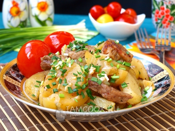 Photo of pork with potatoes in foil in the oven