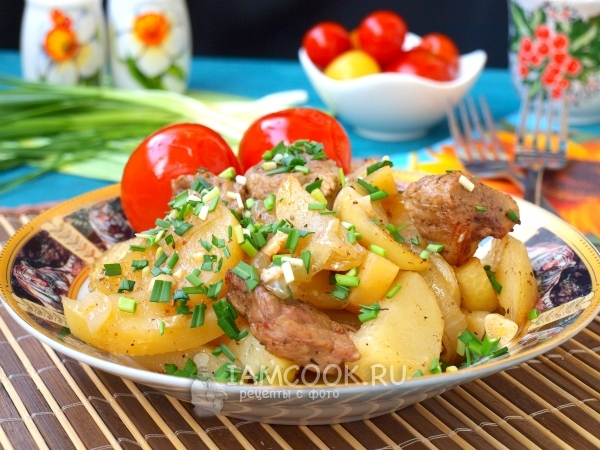Pork with potatoes in foil in the oven