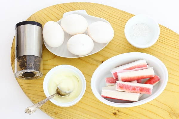 Ingredients for eggs stuffed with crab sticks